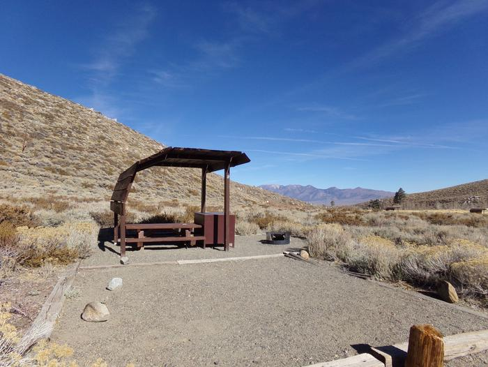 McGee Creek Campground site #13 featuring shaded picnic area with fire pit and camping space.
