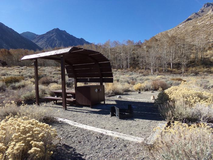 McGee Creek Campground site #17 featuring shaded picnic area with fire pit and camping space.