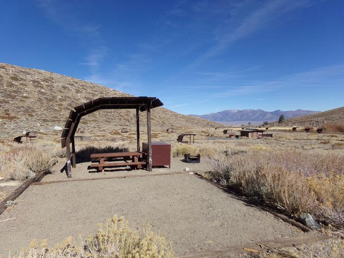 McGee Creek Campground site #20 featuring shaded picnic area with fire pit and camping space.