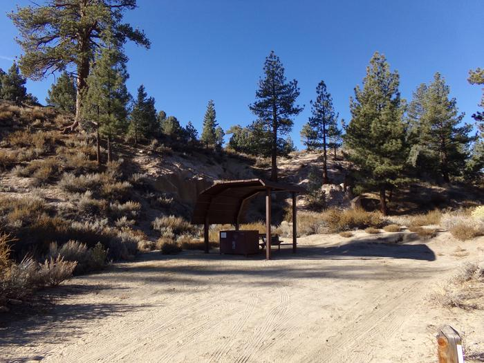 Tuff Campground site #14 featuring shaded picnic area with camping space and fire pit by the mountain side.