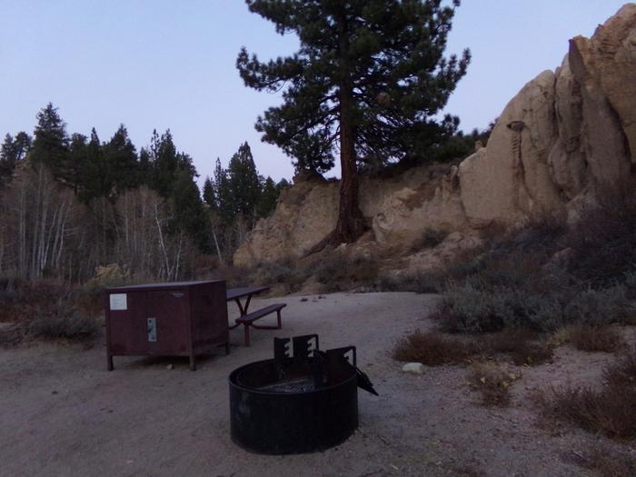 Tuff Campground site #19 featuring picnic area with camping space and fire pit by the mountain side.
