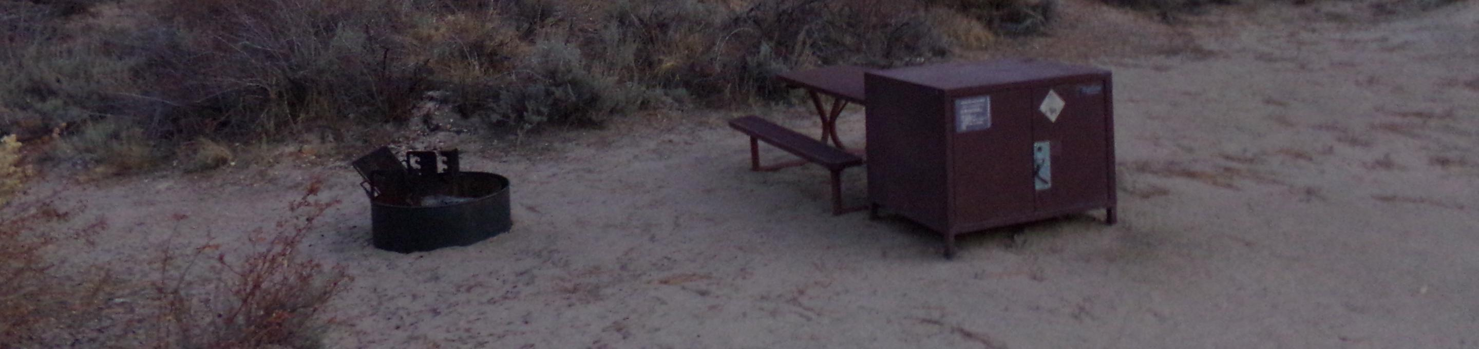 Tuff Campground site #20 featuring picnic area with camping space and fire pit by the mountain side.