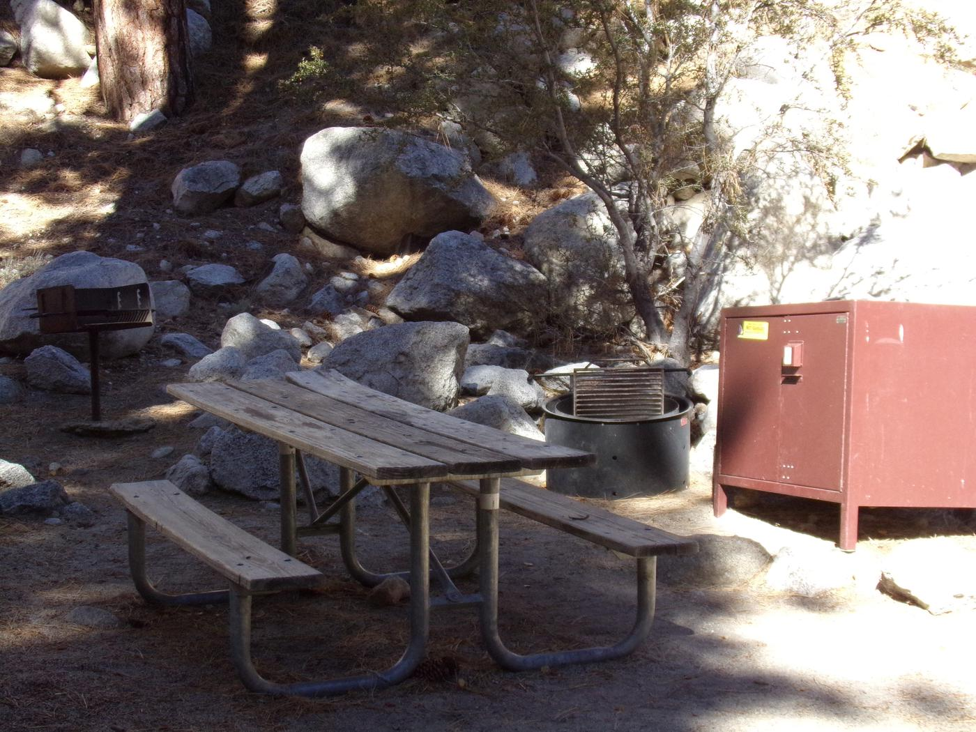 Mt. Whitney Portal Campground site #21 featuring the mountain top setting picnic area with fire pit.