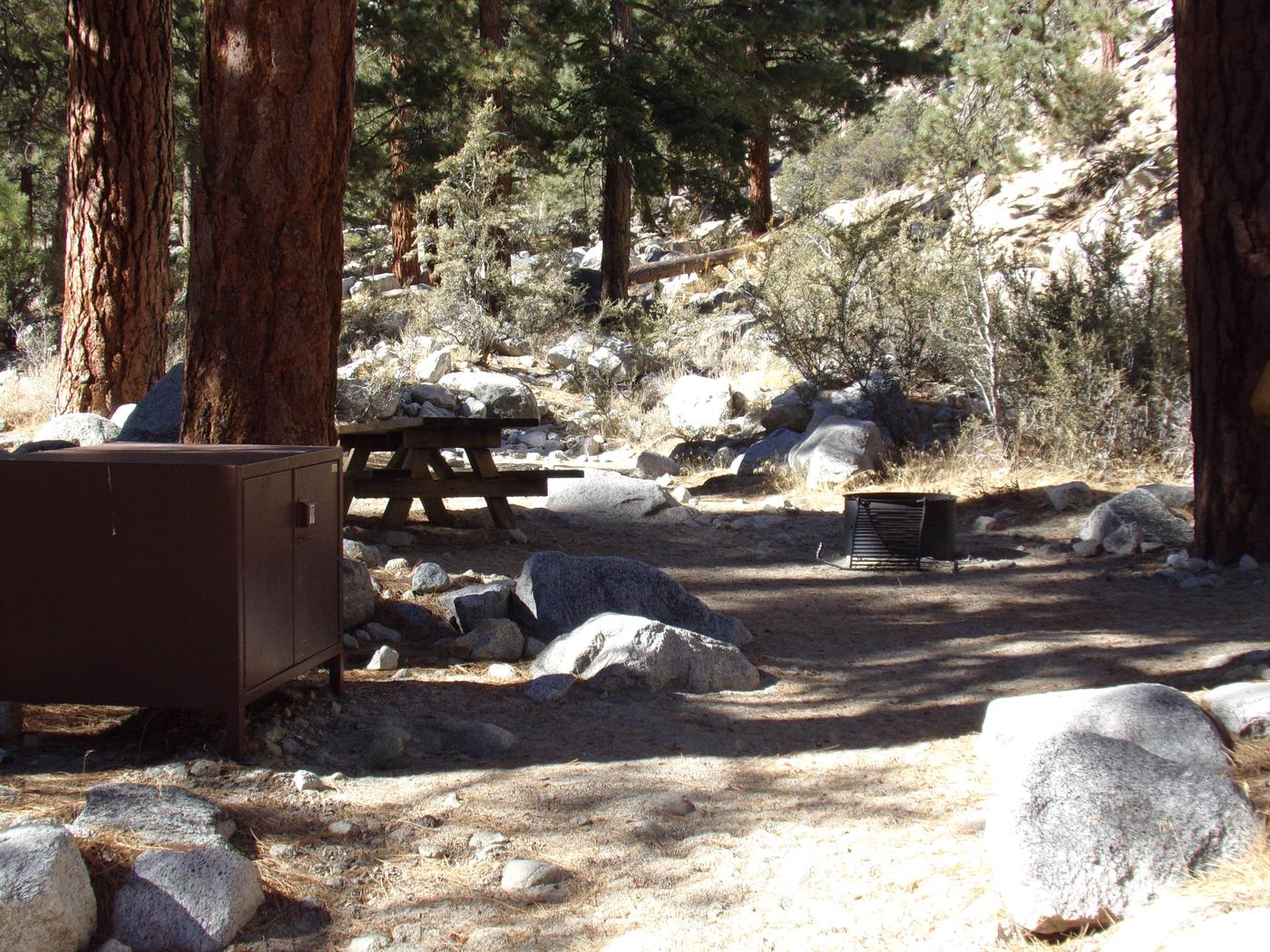 Mt. Whitney Portal Campground site #23 featuring the mountain top setting picnic area with fire pit.