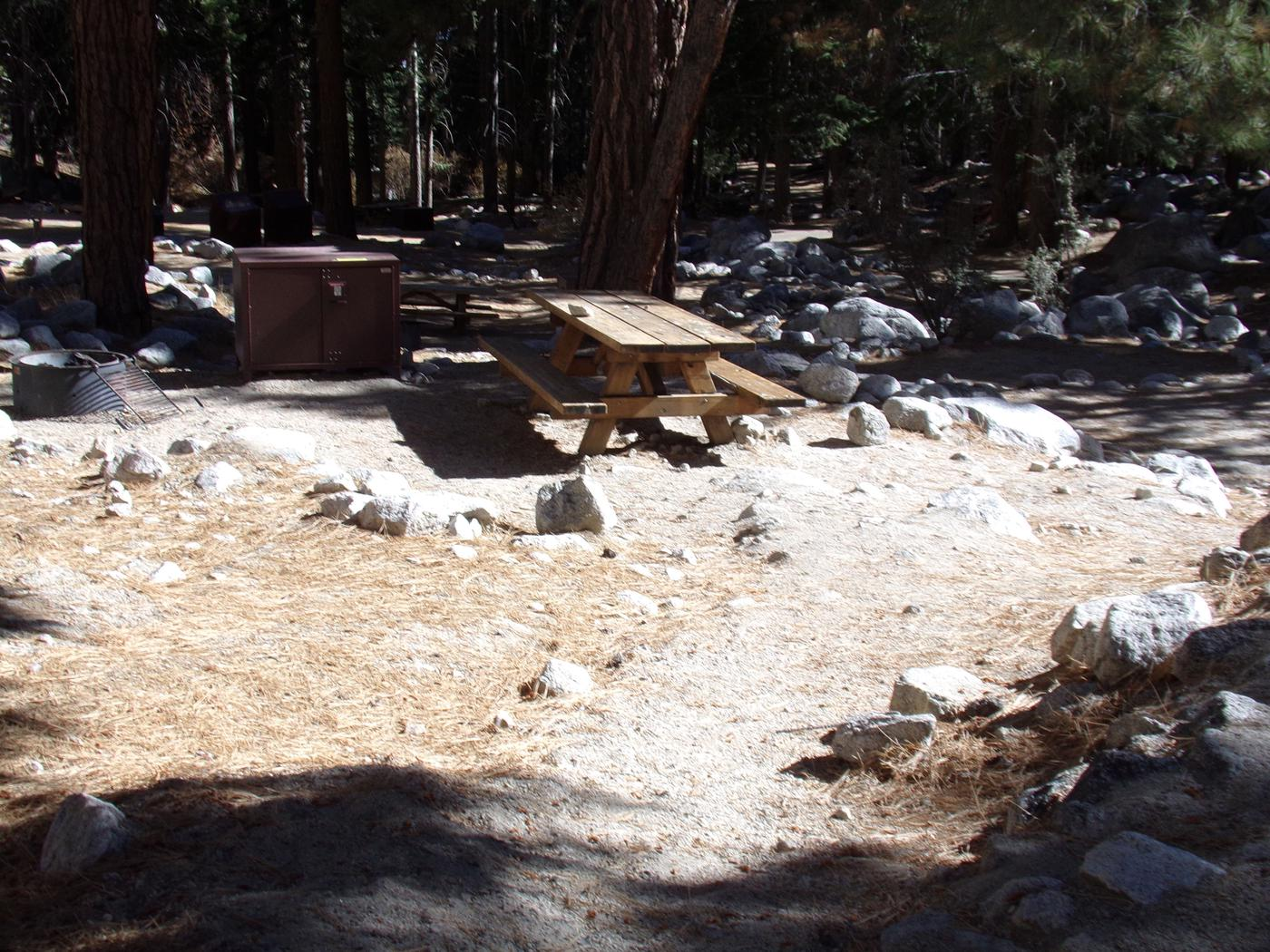 Mt. Whitney Portal Campground site #25 featuring the mountain top setting picnic area with fire pit.