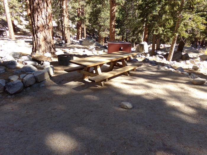 Mt. Whitney Portal Campground site #27 featuring the mountain top setting picnic area with fire pit.