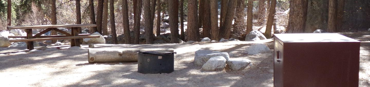 Mt. Whitney Portal Campground site #29 featuring the mountain top setting picnic area with fire pit.