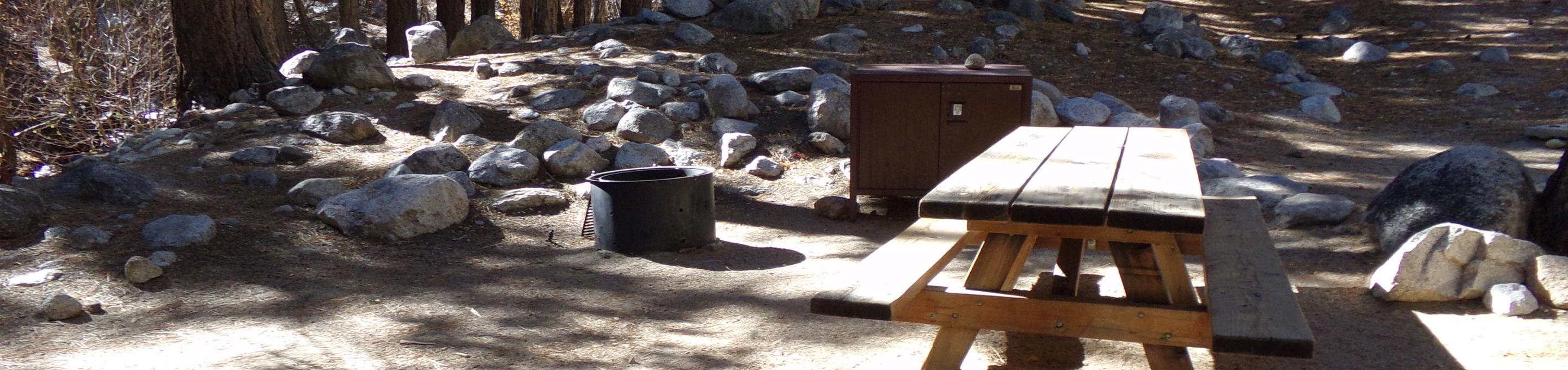 Mt. Whitney Portal Campground site #33 featuring the mountain top setting picnic area and camping space.
