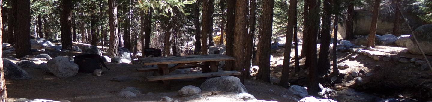 Mt. Whitney Portal Campground site #43 featuring the mountain top setting picnic area and camping space.