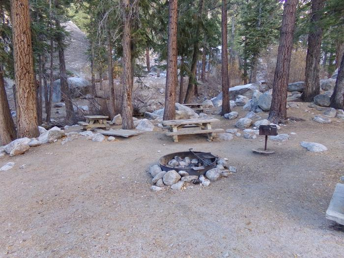 Mt. Whitney Portal Campground Group Site #01 featuring mountain top camping space with multiple picnic tables and fire pits.