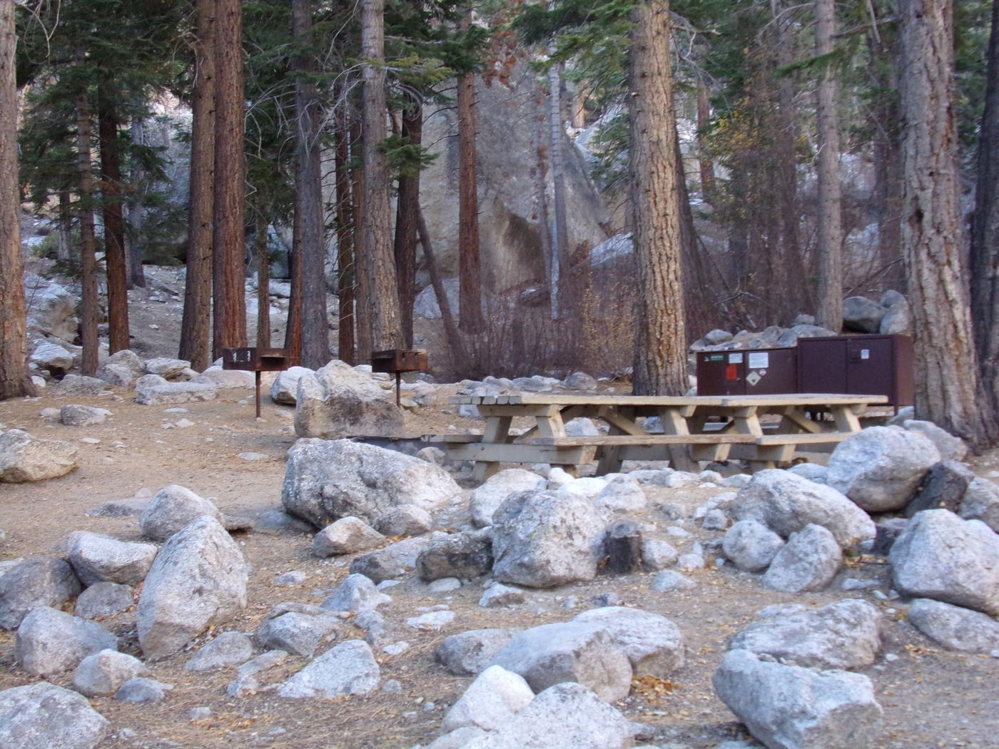 Mt. Whitney Portal Campground Group Site #02 featuring mountain top camping space with multiple picnic tables and fire pits.