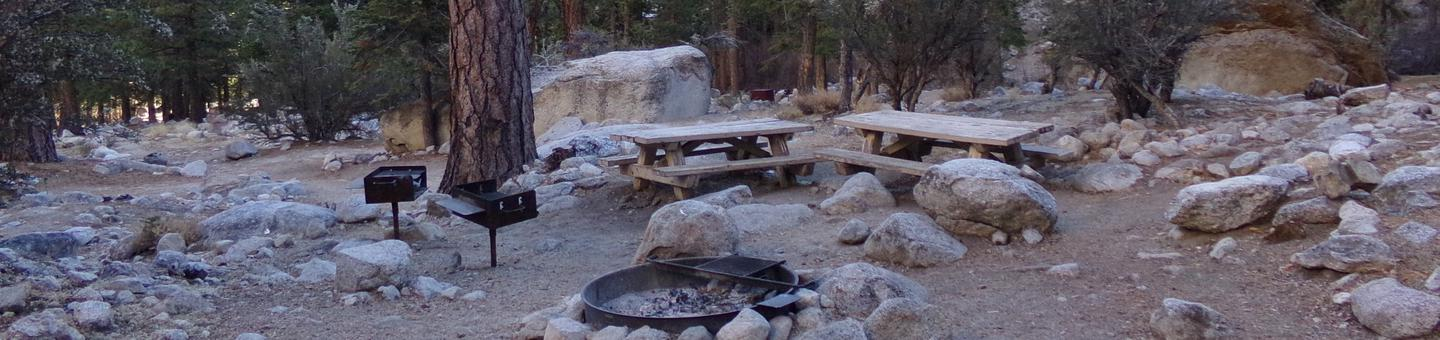 Mt. Whitney Portal Campground Group Site #03 featuring mountain top camping space with multiple picnic tables and fire pits.