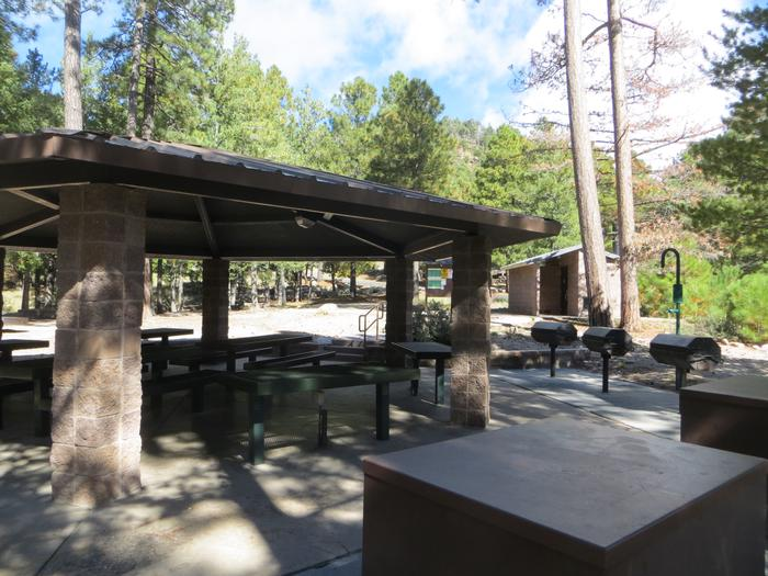 Whitetail Campground Group Site #02 featuring large ramada with multiple picnic tables, camping spaces, and food storage.