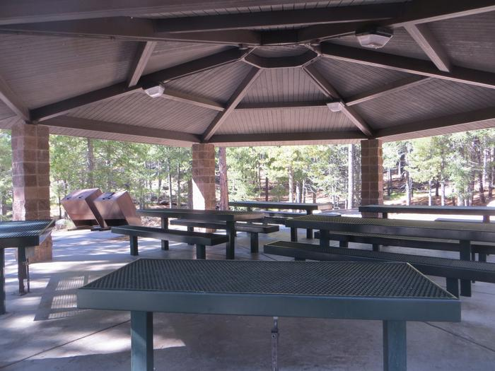 View from inside the ramada featuring the picnic area at Group Site #02, Whitetail Campground.