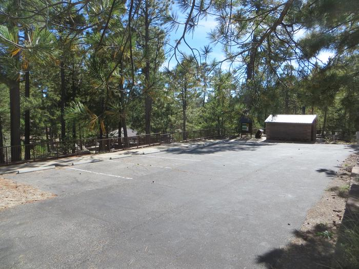 Large parking lot view and access to the private restroom at Group Site #03, Whitetail Campground.