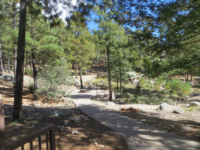 Sidewalk ramp leading to the large camping spaces at Group Site #03, Whitetail Campground.