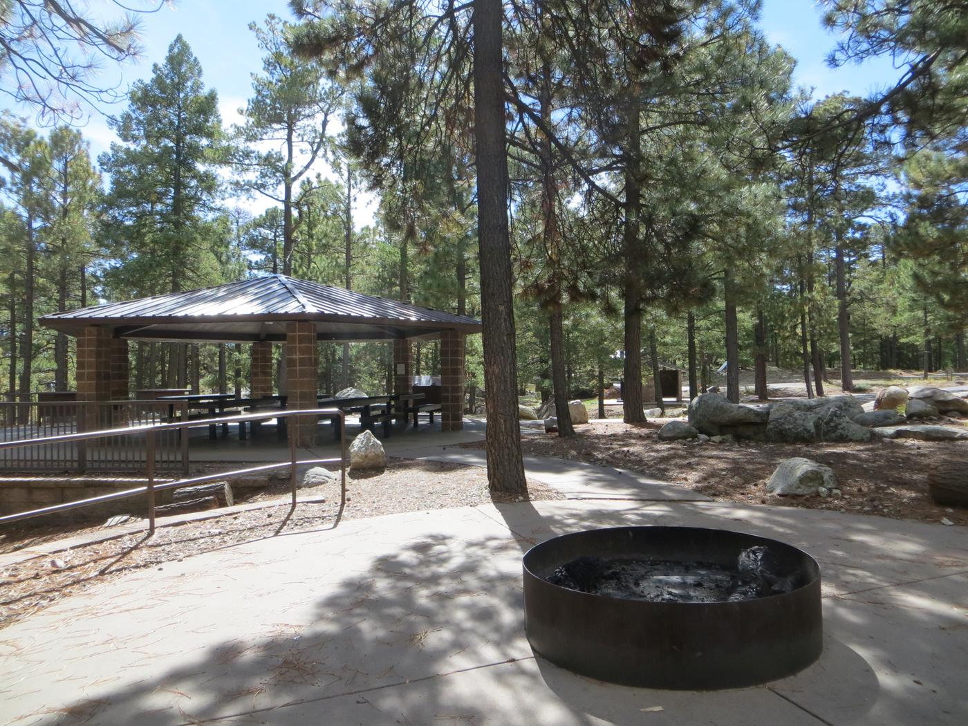 Whitetail Campground Group Site #04 featuring large ramada with multiple picnic tables, fire pit, and food storage.