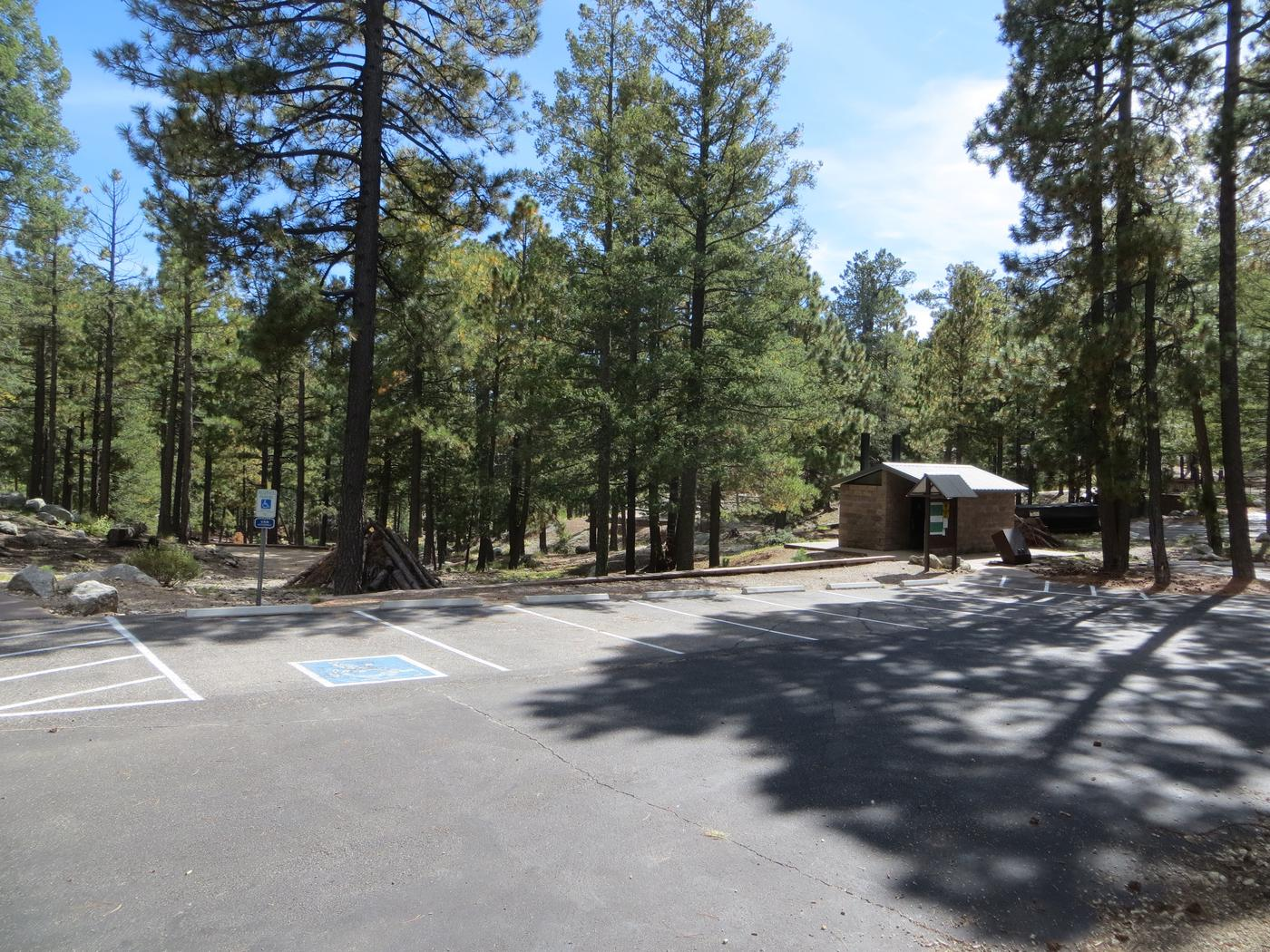 Whitetail Campground Group Site #04 parking lot view and access to the private restroom.