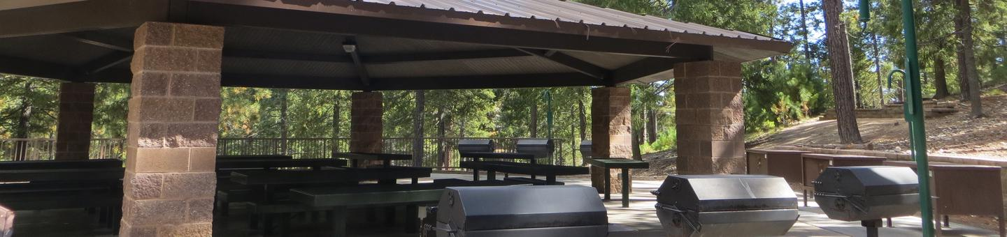 Whitetail Campground Group Site #05 featuring large ramada with multiple picnic tables and food storage.