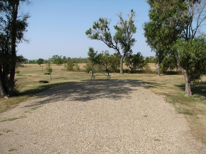 Hazelton Recreation Area Campsite #16Hazelton Recreation Area campsite #16.  Campsite includes a fire pit and a picnic table.