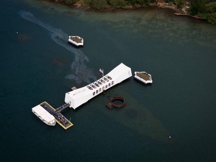 An aerial view of the USS Arizona Memorial over the sunken USS Arizona.