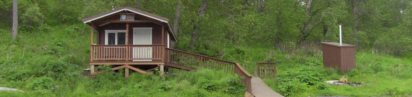 Cabin and outhouse with pathUganik Lake Cabin