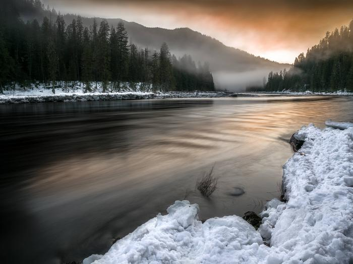 A misty winter sunset at the headwaters of the Clearwater River near the convergence of the Lochsa and Selway Rivers in northern Idaho.Headwaters of the Clearwater River