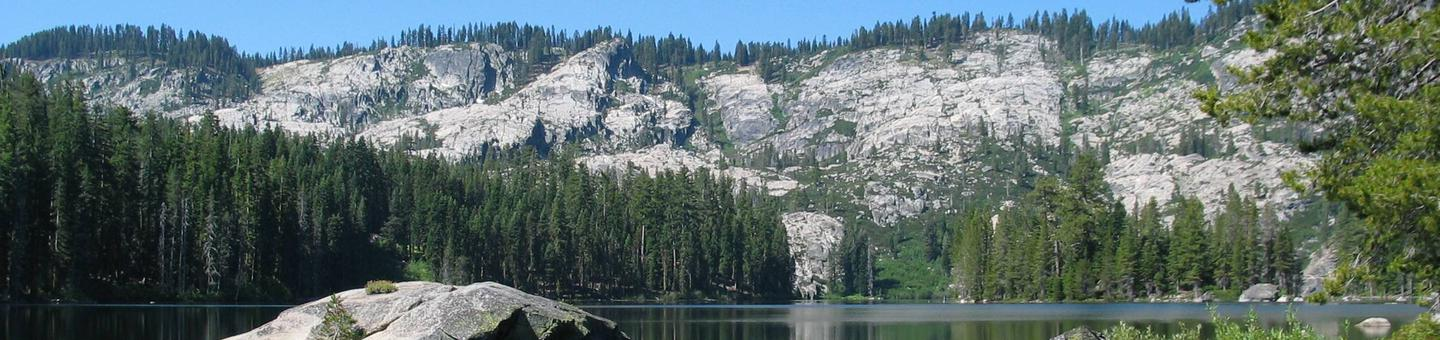 Mountain lake with distant rocky shoreSliver Lake, Plumas National Forest