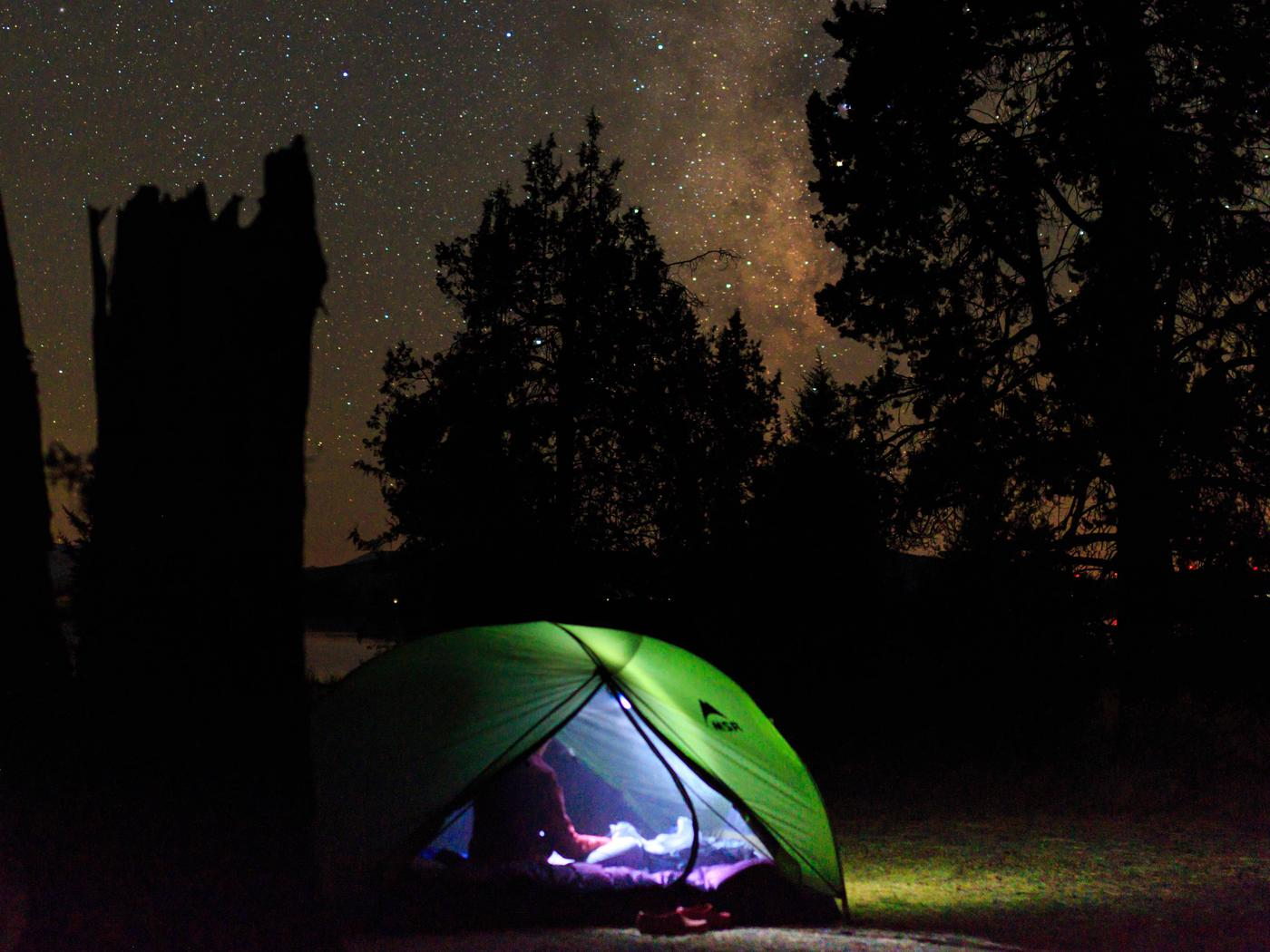 Tent at night with Milky Way overheadNighttime reading in Plumas National Forest