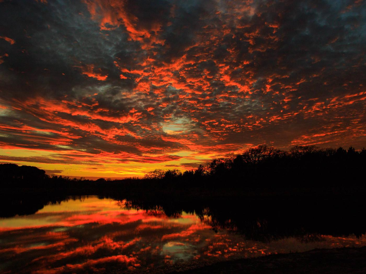 Sunset and reflection on Black Creek LakeBlack Creek Lake on the LBJ Grasslands in Texas