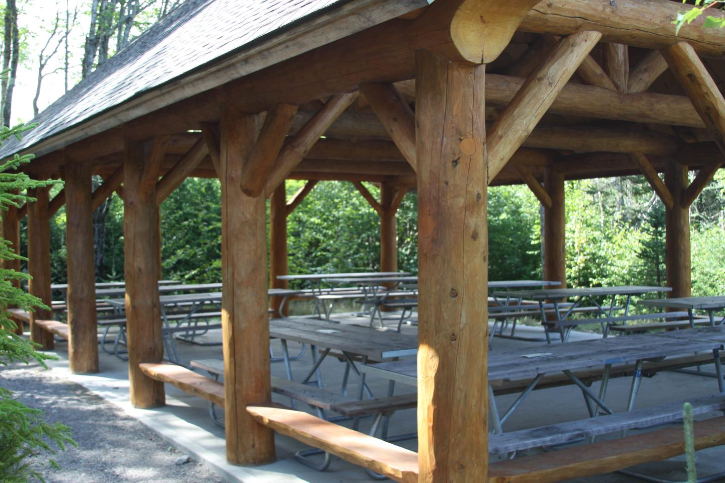 A covered pavilion for shared use of picnic tables.Shared group sites pavilion.