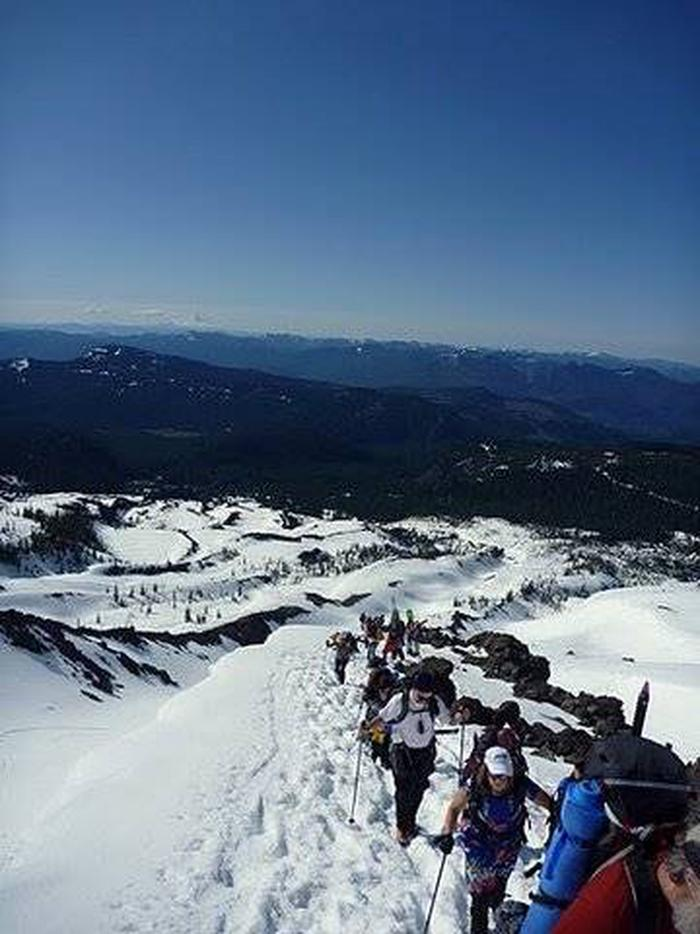 Climbers Cross a Snowfield Enroute to the Summit