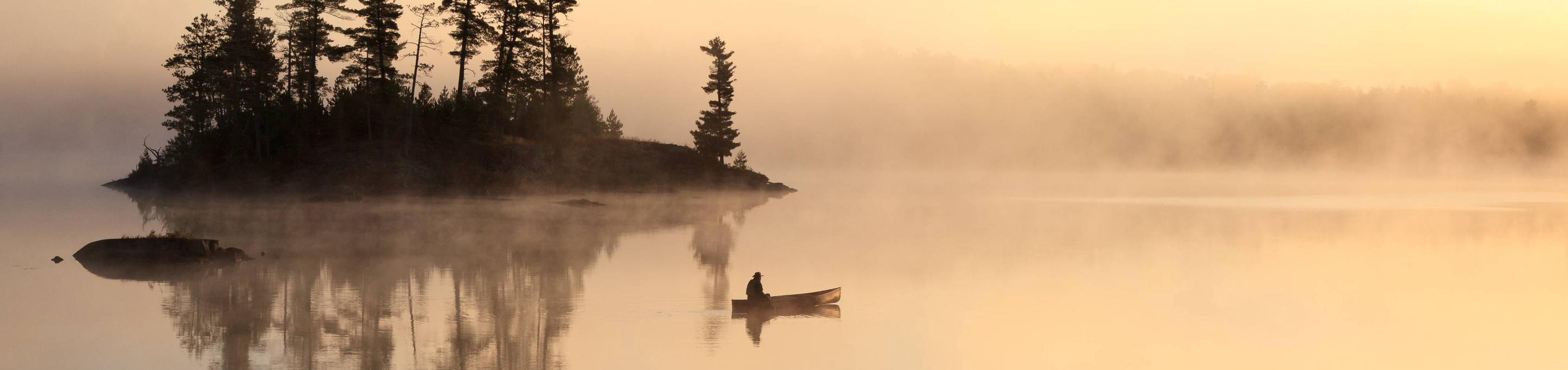 Paddler drifting on the water in Boundary Waters Canoe Area Wilderness.