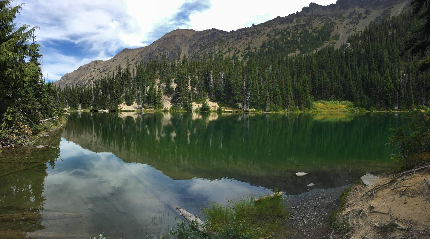 Subalpine Lake surrounded for mountains and forest Royal Lake