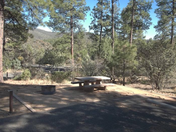 Site 31 Wide Paved Parking With Cement Table and Metal Fire Ring On Decomposed Granite All Shaded By Ponderosa Pines Hilltop Site #31