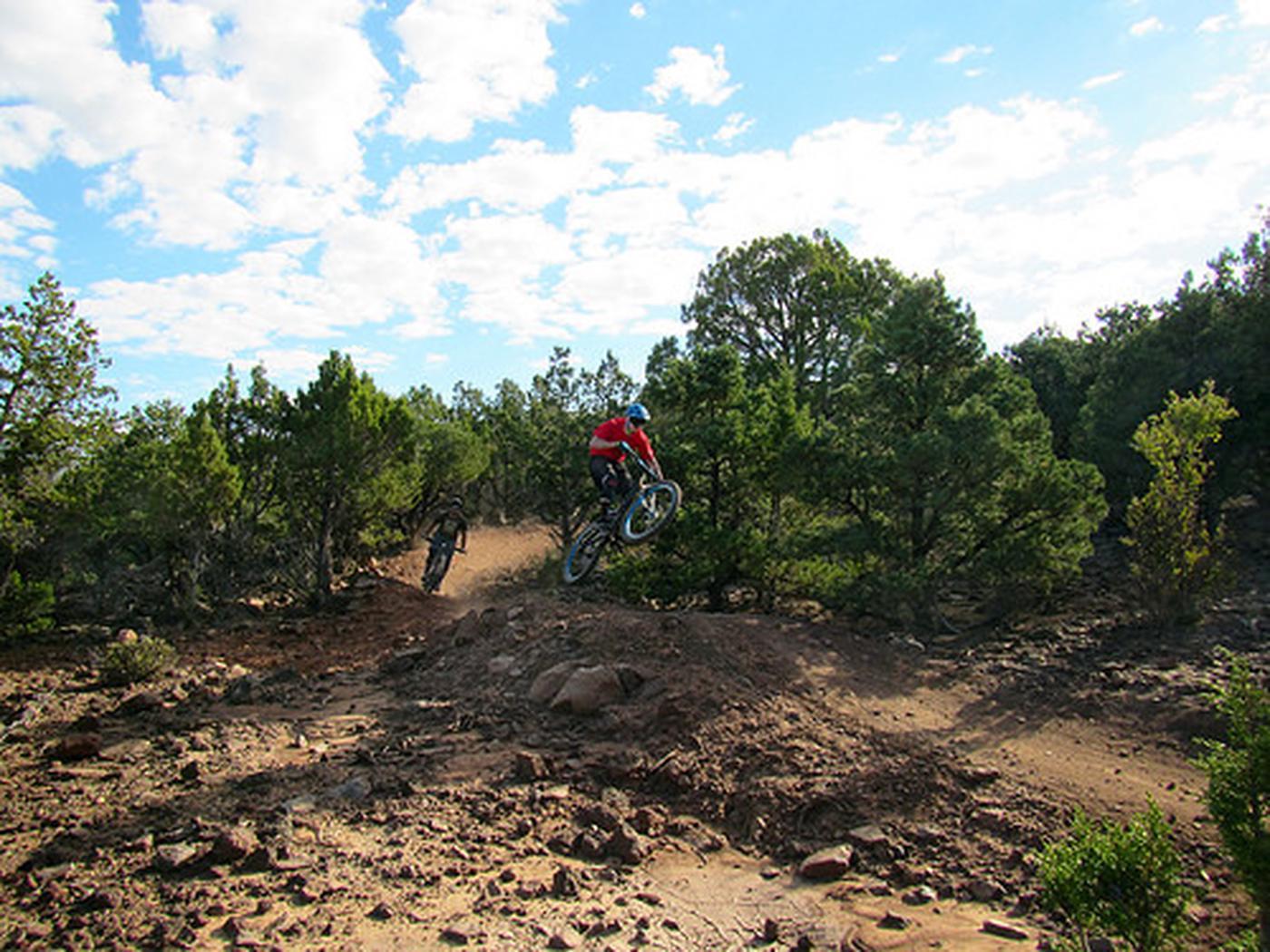 Lava Flow Trail RideMountain bikers enjoy the Table Top Lava Trail. Credit: Ceder City Field Office, UT.
