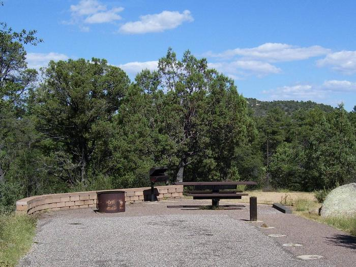 Yavapai Campground Site 3 with one ballard in walkway, and the table in front of the tent pad. No shade Yavapai Campground Site #3