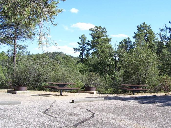 Yavapai Campground Site #7 with two fire pits and picnic tables.  The parking area is shared with Site #6. No shade in parking area. Yavapai Campground Site #7