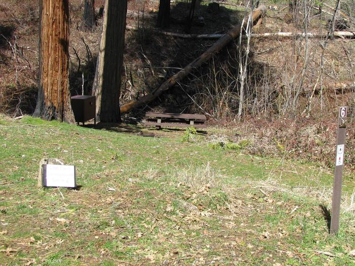 Native surface site with picnic table, fire ring and bear-proof food storage boxLost Claim Campground Site #6