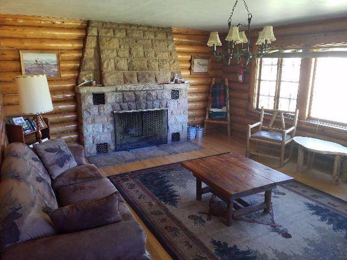 Sunlight Rangers Cabin - Living Room coffee table, fireplace and seatingSunlight Rangers Cabin's cozy living room.