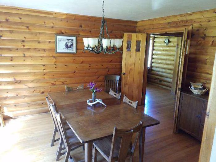 Sunlight Rangers Cabin - Dining Area dark brown table and 6 chairsSunlight Rangers Cabin's Dining Room