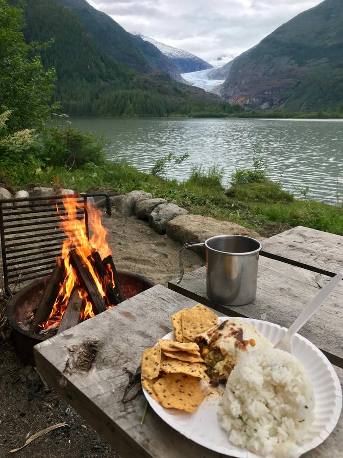 Food and fire at picnic table