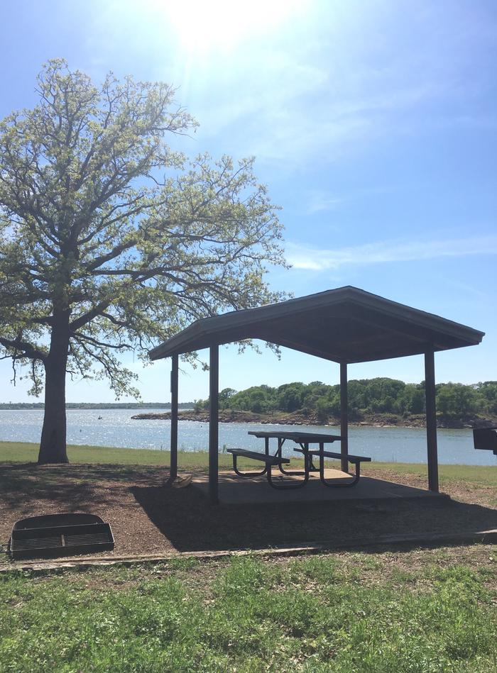 Site 28Site 28 is located between 27 and 29. This site has a great view of the lake and some awesome shade trees.