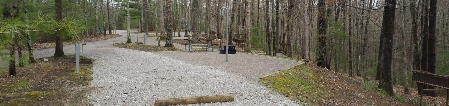 Rocky parking pad with campsite nearby.Station Camp Campground