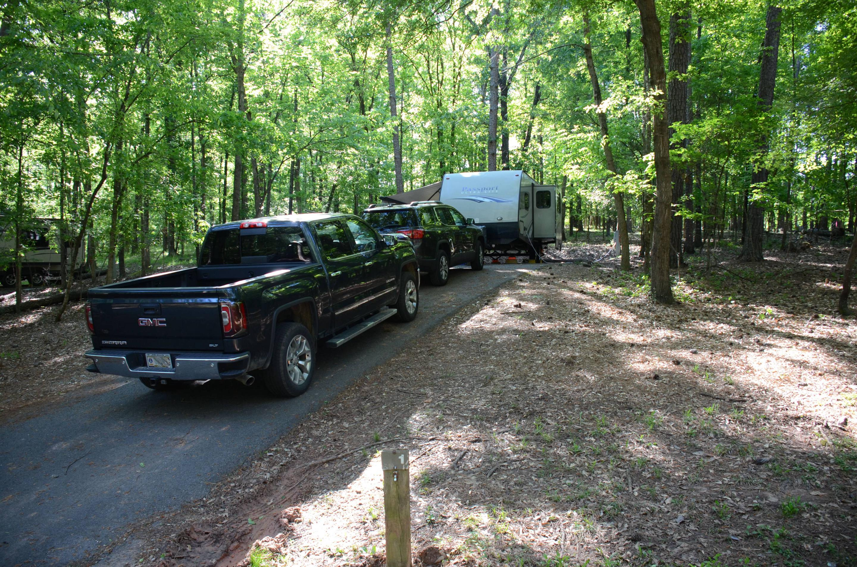 Driveway slope, tree clearance on utilities side.McKinney Campground, Campsite #1