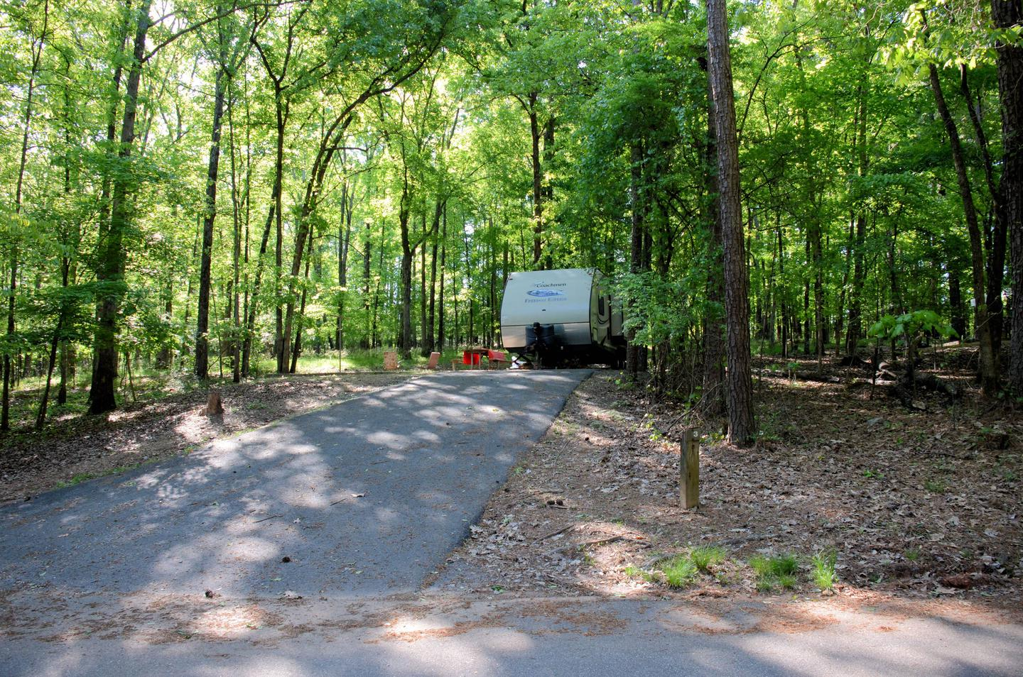 Driveway slope, tree clearance utilities side.McKinney Campground, Campsite #3