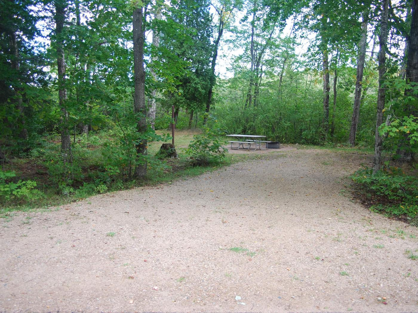 AuTrain Lake Campground site #12 full site view with table, fire pit, and picnic table.