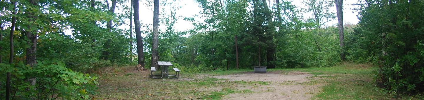 AuTrain Lake Campground site #13 full site view with table, fire pit, and picnic table.