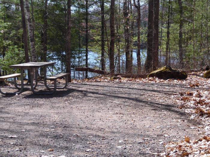 Two Lakes Campground site #79 with picnic table view among the trees.