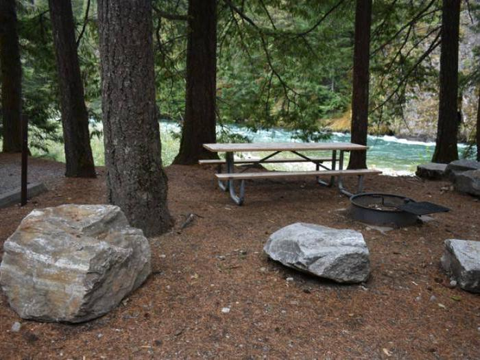 Picnic table and fire ring at Gorge Lake Campground site 1.Site 1 at Gorge Lake Campground